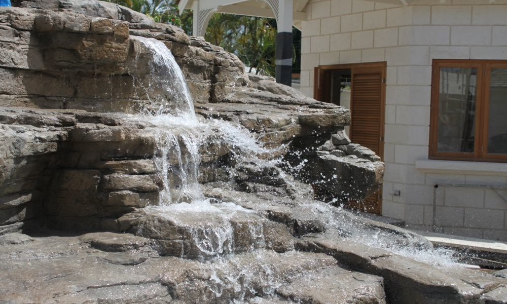 Rockwork and waterfall for West Indies koi pool