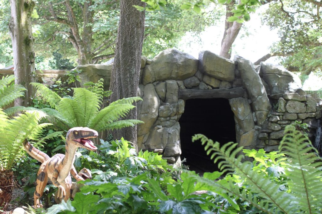train tunnel entrance with dinosaur